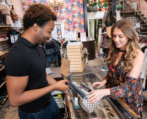 Woman buying handbag from a Closet Trading Company Boutique